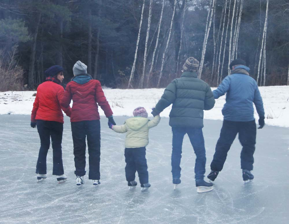 A family ice skating at Canterbury Farm